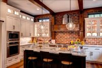 Brick wall in kitchen with white cabinets, glass cabinet ...