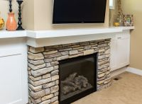 Modern built-ins on each side of a Lennox gas fireplace ...