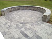 A beautiful Paver Patio with a Stone Seating/Border Wall ...