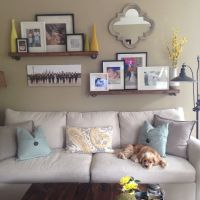 Family room wall collage above the couch. Shelves from ...
