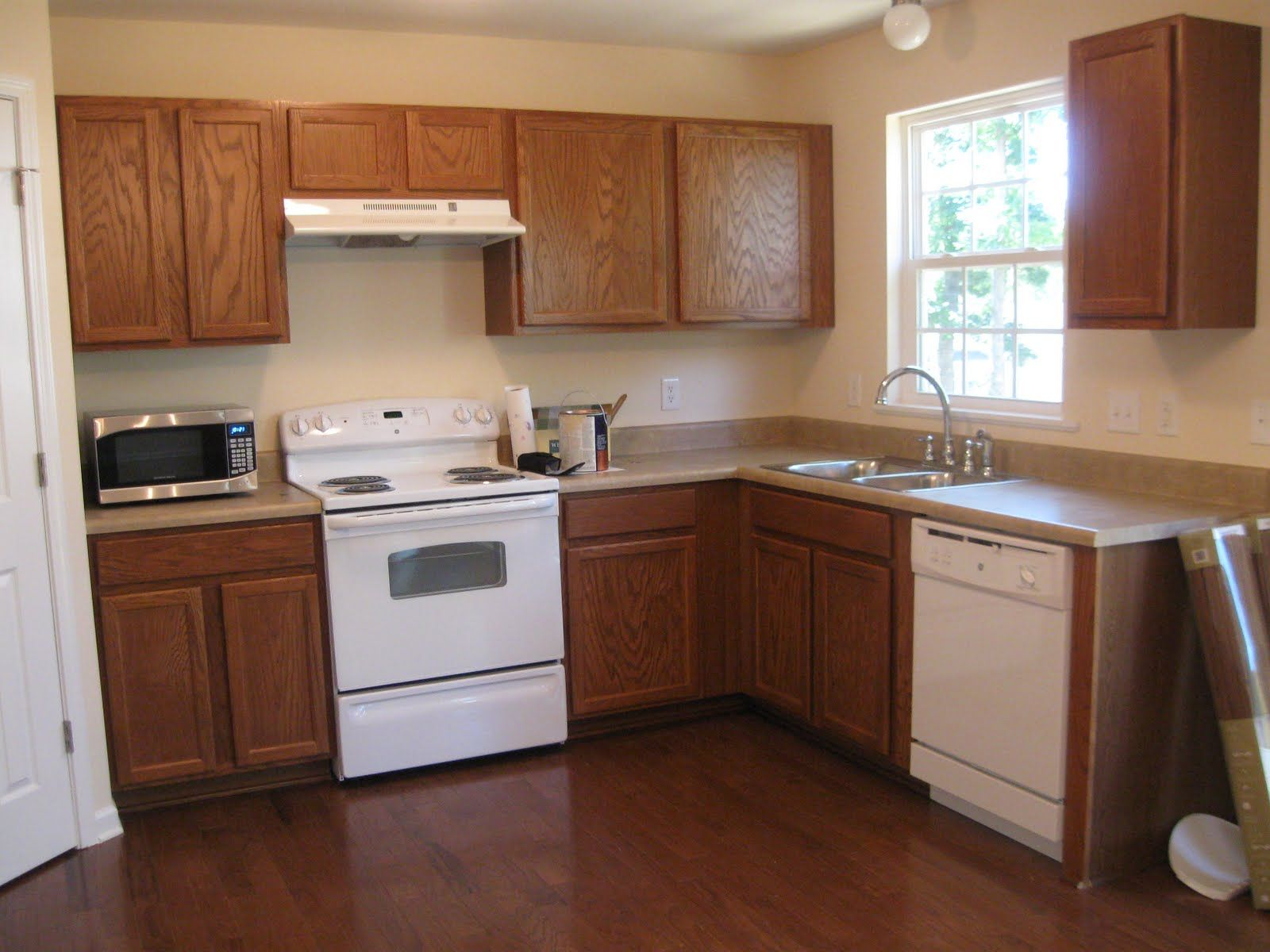 pictures of oak kitchen cabinets painted white oak kitchen cabinets Red Kitchen Walls With Oak Cabinets Newremodelaholic Painting