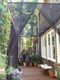Mosquito Netting Curtains for a DIY Screen Patio ...