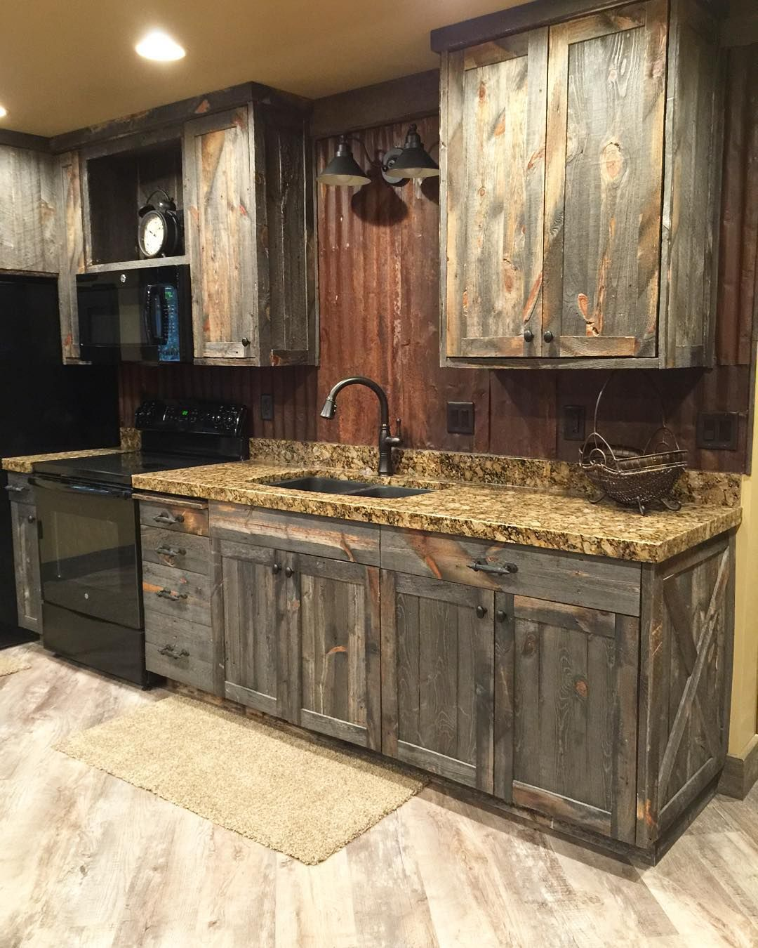 A little barnwood kitchen cabinets and corrugated steel backsplash love how rustic and homey it