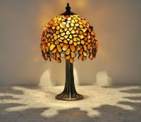 Small amber table lamp - tiffany technique. The lamp is ...