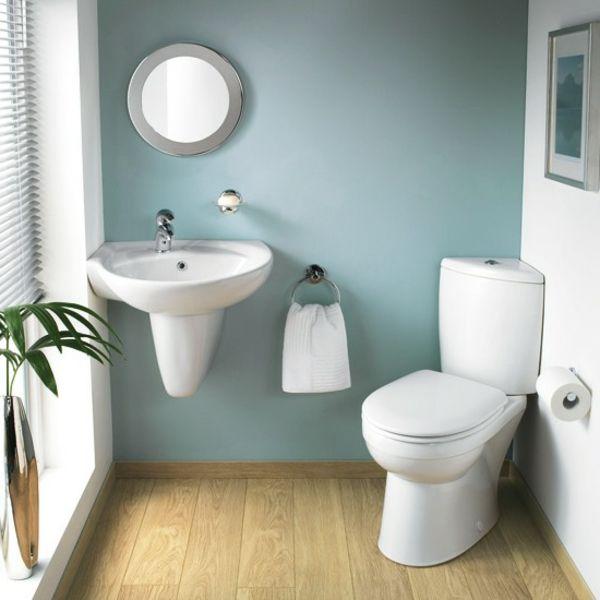badezimmer- weiß-und-grau - mit einer grünen pflanze - 30 super - badezimmer 30er