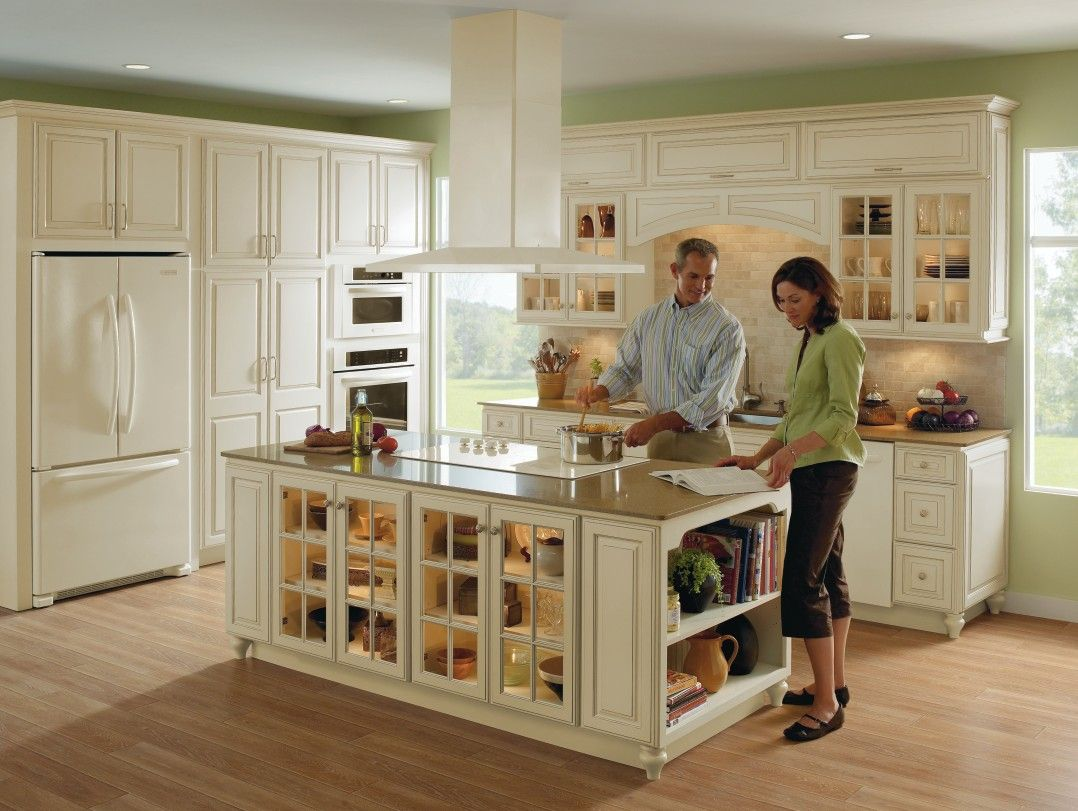 homecrest cabinetry kitchen island cabinets Spacious kitchen in ivory with fawn glaze and beige granite against light oak wood flooring uses