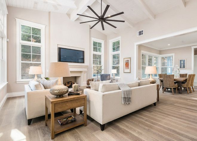 Neutral living room paint color is Sherwin Williams Popular Gray - living room paint color