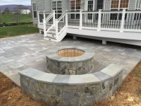 A beautiful Paver Patio with Stone Seating Walls and a ...