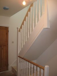 A softwood staircase for a loft conversion, painted white ...