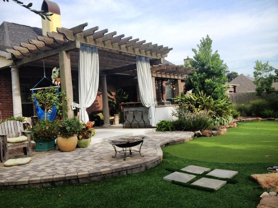 Love this next to carport with sitting area and a gravel