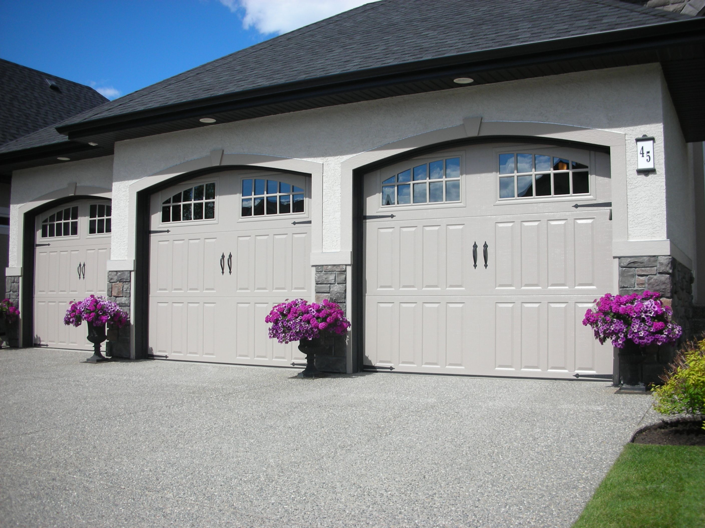 Amarr classica bordeaux garage door with seine windows visit www amarr com