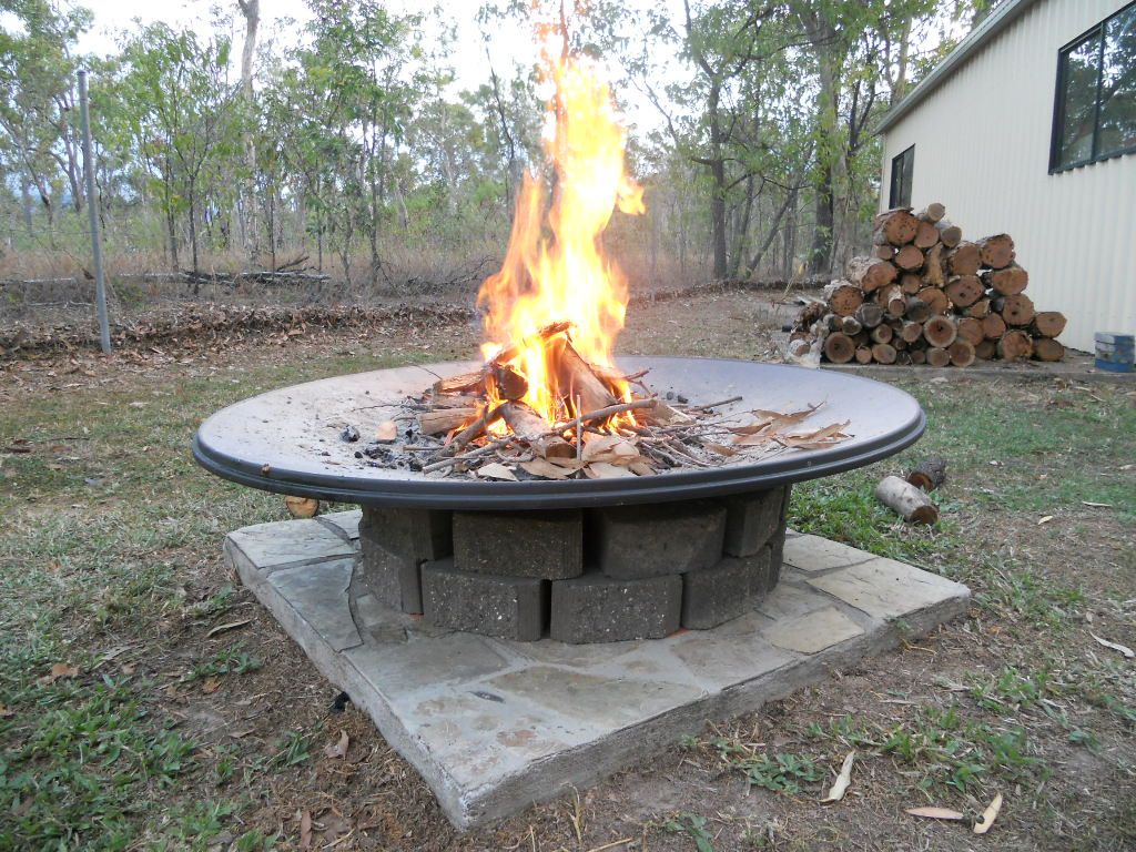Old satellite dish upcycled as an aus star firepit