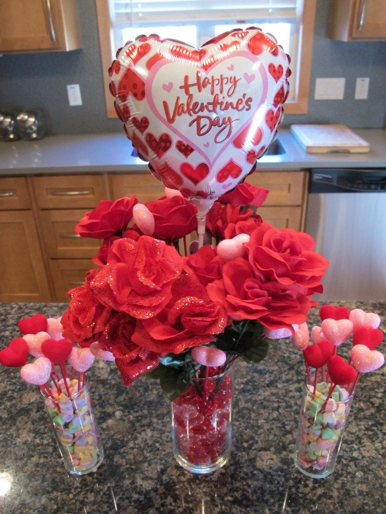 Romantic centerpiece with beautiful heart shaped happy valentine s day balloon and wonderful red flowers on glass holder for dazzling valentine s day