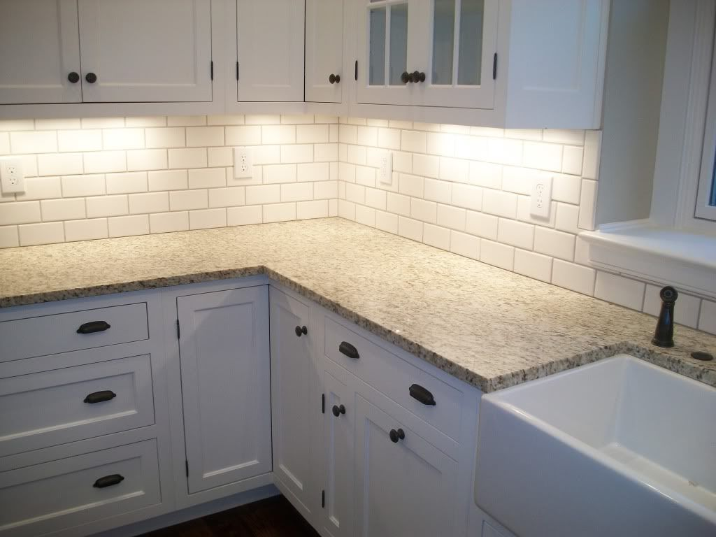 kitchen colors and tile subway tile kitchen backsplash giallo ornamental granite with biscuit subway tile backsplash Google Search