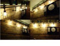Pallet wall, industrial lighting, Edison bulbs, dart board ...