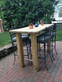 We wanted a bar height table, so found an old picnic table ...