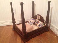Homemade dog bed. It's an end table turned upside down. I ...