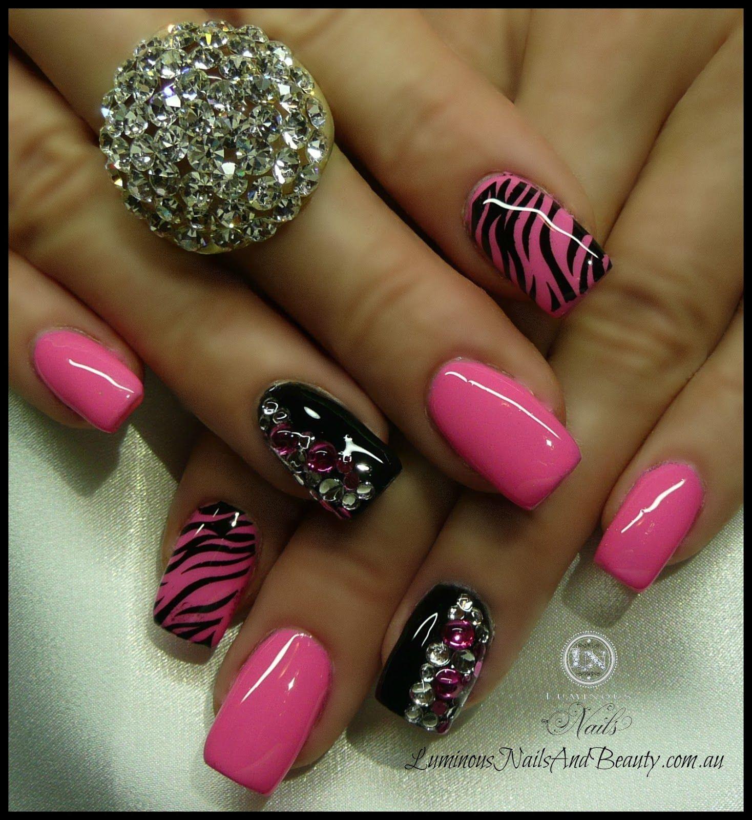 Luminous nails hot pink black nails with zebra print crystals