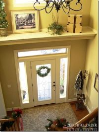 Add a shelf above the door to break up the large wall ...