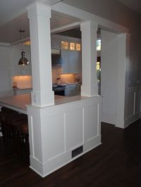 Half wall with pillars to separate an eat-in kitchen from ...
