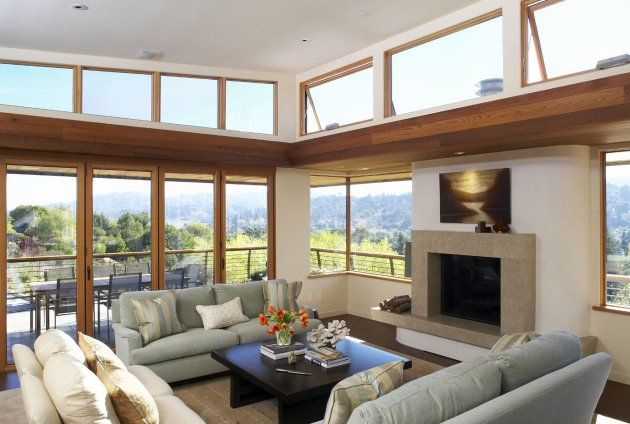 Love the backdrop of windows behind a living room idea as well as - living room windows