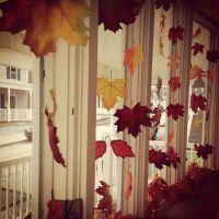 Fall bay window decorating idea... fabric leaves tied onto ...