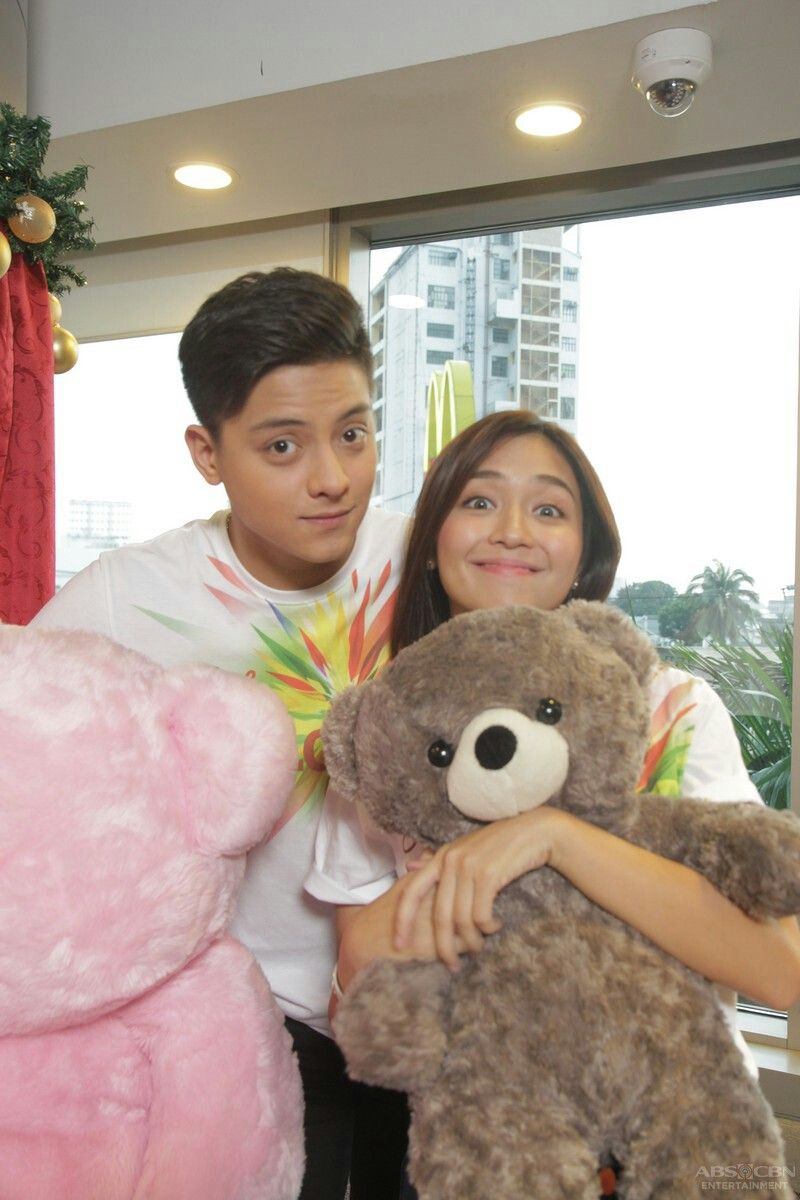This is kathryn bernardo and daniel padilla smiling and posing for the camera during the taping
