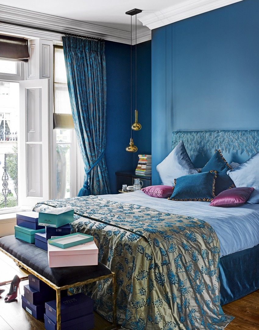 Modern blue bedroom with moroccan themed fabrics minus pink plus green