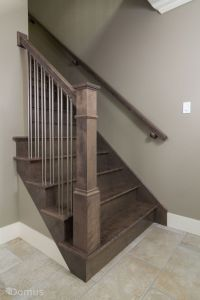 Dark stained staircase with modern stainless spindles ...