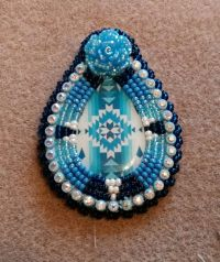 Native American beaded earrings featuring a pear shaped ...