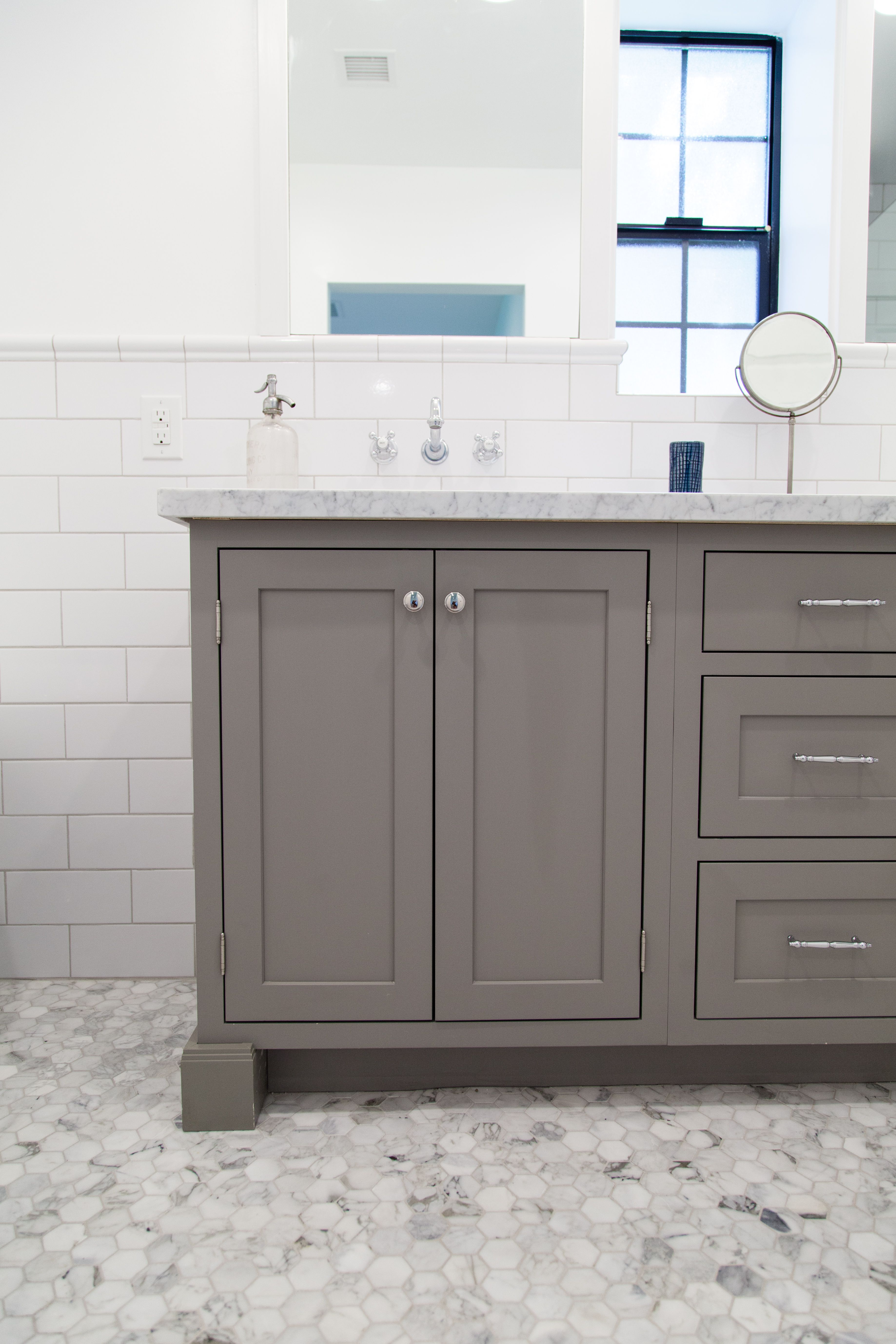 Grey shaker style vanity with inset doors by rafterhouse