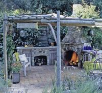Outdoor Kitchen Design Ideas | Rustic pergola, Stone ...