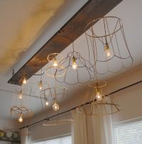 grouping of pendant lights using old lampshade frames ...