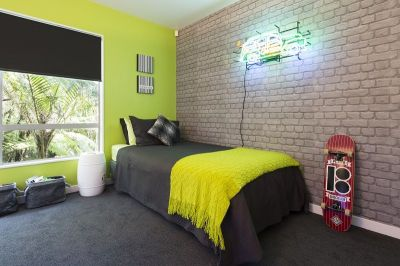 The final reveal! A zingy lime green wall teamed with cool exposed brick wallpaper and charcoal ...