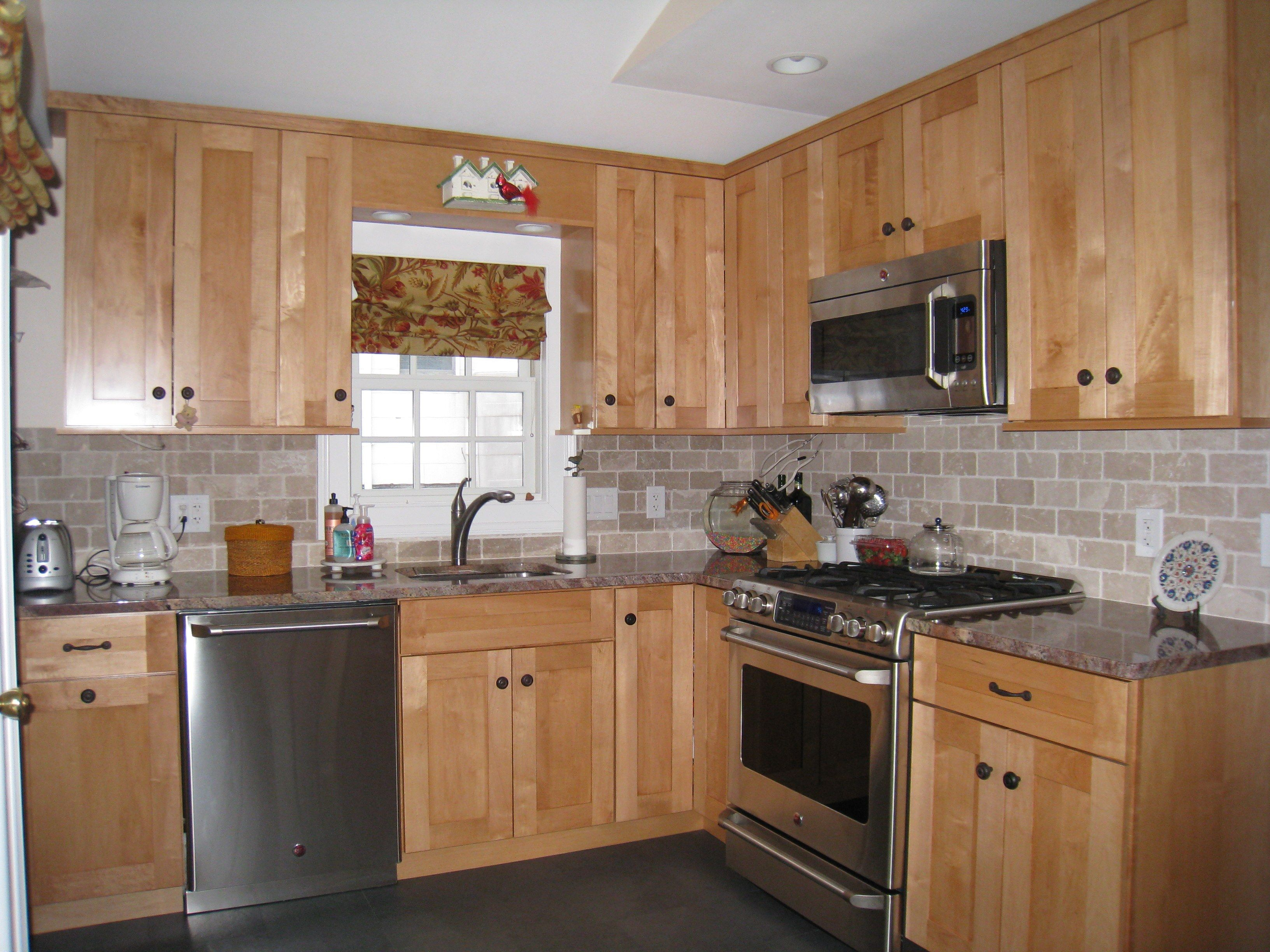 Maple Kitchen Cabinets With Marble Countertops Oak Cabinets White Subway Tile Windswept Blue Walls