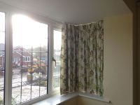 Curtain track in square bay window.