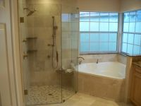 corner tub w/ larger walk in shower. do not like the wall ...