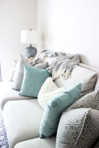 Bright White Living Room, Printed Pillows, Neutral Couch ...