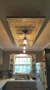 Old door on the ceiling with two hanging lights. Great ...