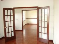 Stained trim french doors and chair rail with hardwood ...