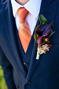 Orange Tie and Purple Cala Lily Boutonniere | Wedding ...