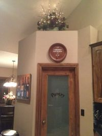 Above cabinet/pantry door ideas. Decor purchased at Hobby ...