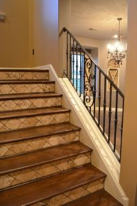 Iron railing, tumbled tile risers and stained wood treads