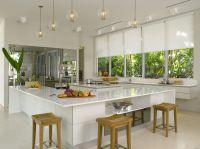 A brilliant white kitchen design with Silhouette window ...