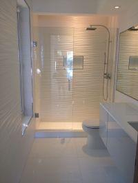 All white bathroom...gorgeous! Wall tile, toilet, vanity ...