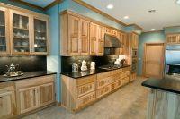 Black granite, hickory cabinets, blue walls | House Design ...