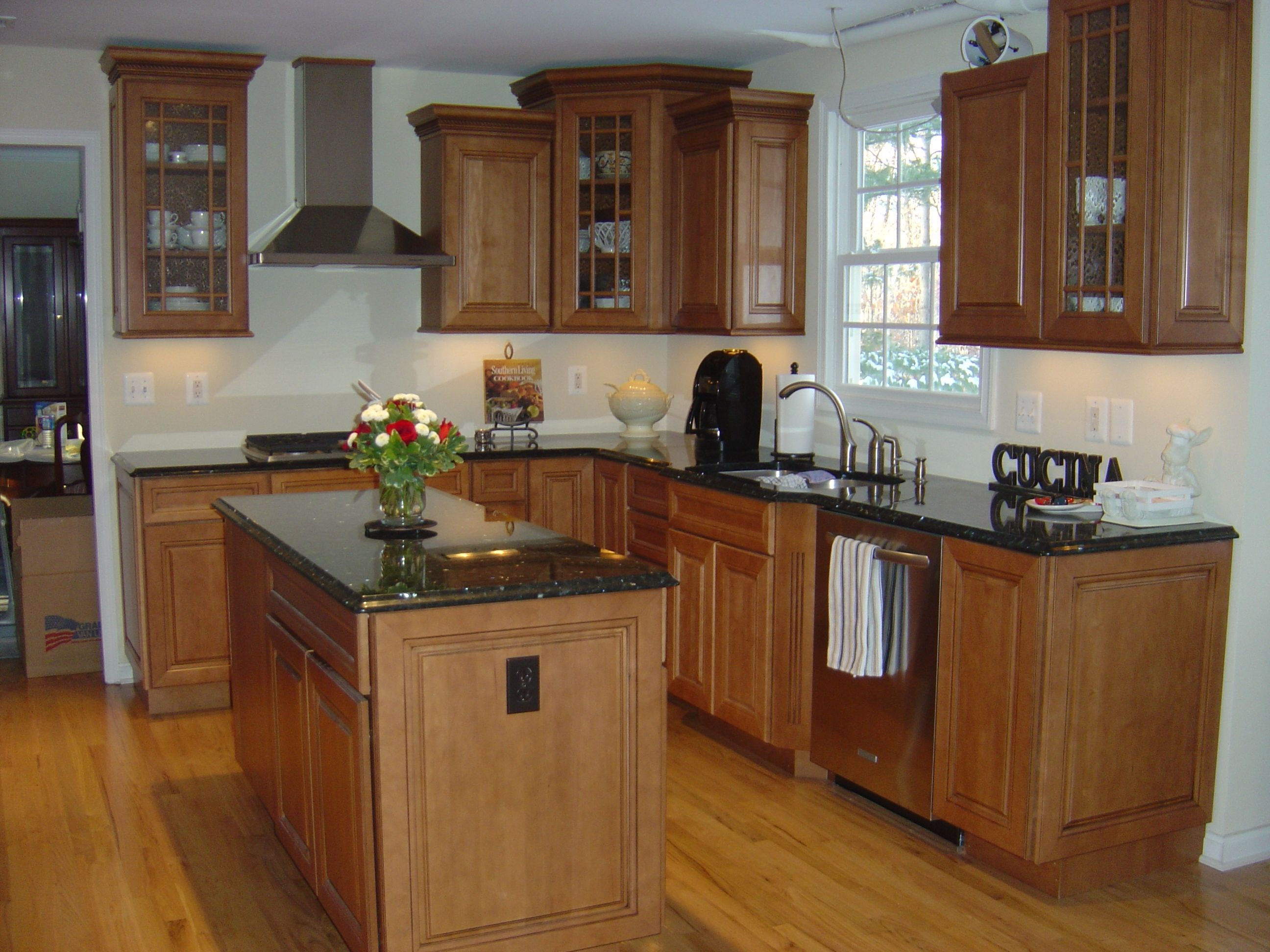 Maple cabinets with black countertops