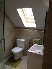 A loft conversion bathroom featuring Roman's Embrace ...
