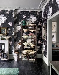 Dramatic living room with dark floral wallpaper ...