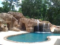 Great waterfall into pool with hidden grotto and a slide ...